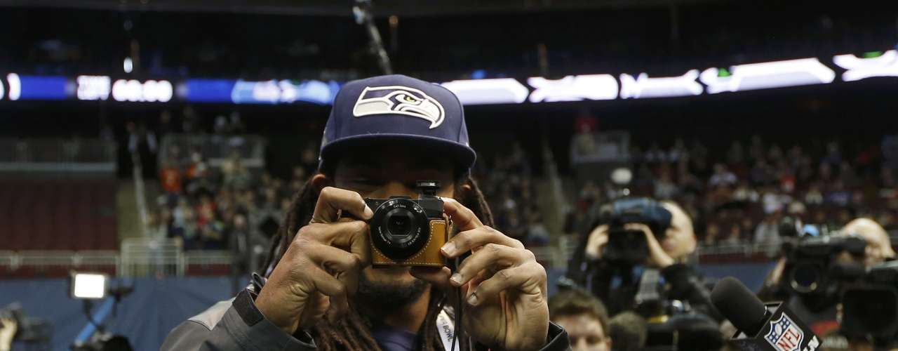 Seattle Seahawks cornerback Richard Sherman takes some pictures as he arrives for Media Day for Super Bowl XLVIII.