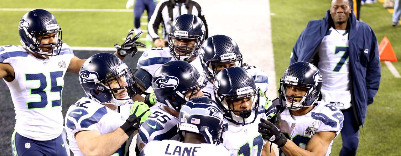 Seattle Seahawks wide receiver Percy Harvin (11) celebrates with teammates after returning a kick for a touchdown against the Denver Broncos.