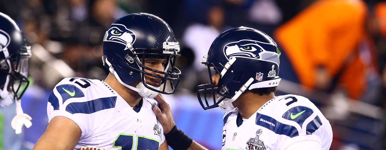 Seattle Seahawks wide receiver Jermaine Kearse (15) celebrates with quarterback Russell Wilson (3) after scoring a touchdown against the Denver Broncos during the third quarter.