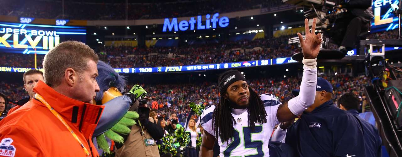 Seattle Seahawks cornerback Richard Sherman (25) is carted off the field after sustaining an injury in the fourth quarter.