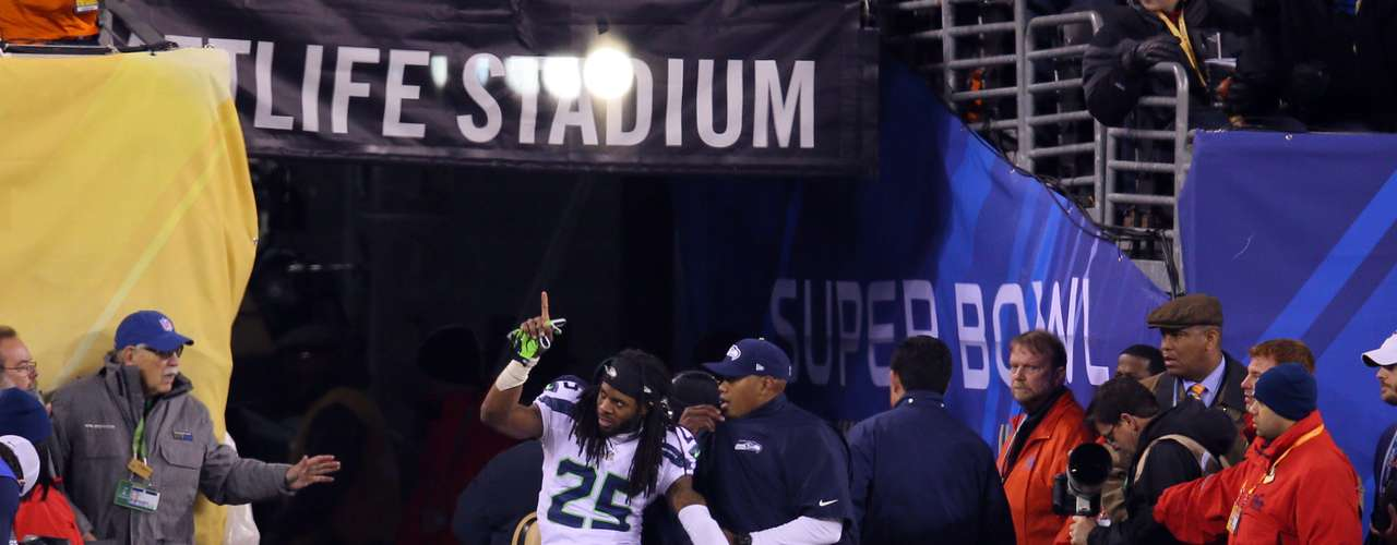 Seattle Seahawks cornerback Richard Sherman (25) is taken off the field after being injured during the second half against the Denver Broncos.
