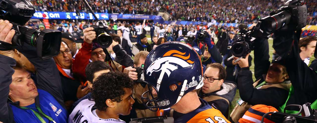 Seattle Seahawks quarterback Russell Wilson (3) shakes hands with Denver Broncos quarterback Peyton Manning (18) after Super Bowl XLVIII.