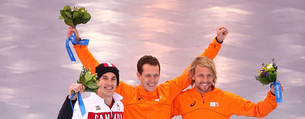 Silver medalist Denny Morrison of Canada, gold medalist Stefan Groothuis of the Netherlands and bronze medalist Michel Mulder of the Netherlands after the men's 100-meter competition.