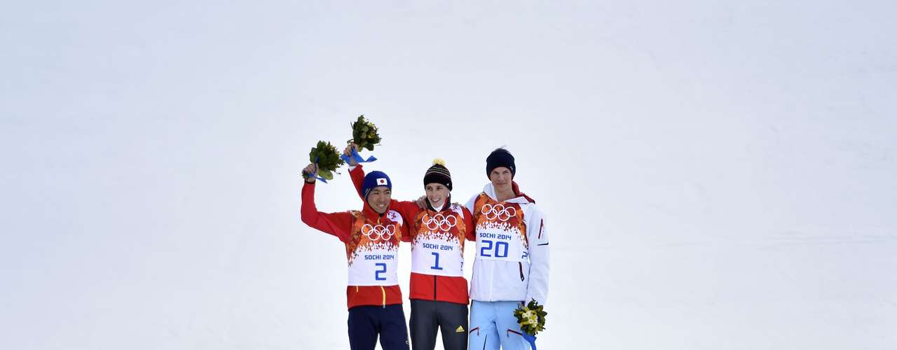 Eric Frenzel of Germany wins the gold medal, Akito Watabe of Japan wins the silver medal, Magnus Krog of Norway wins the bronze medal during the Nordic Combined Normal Hill/10km.