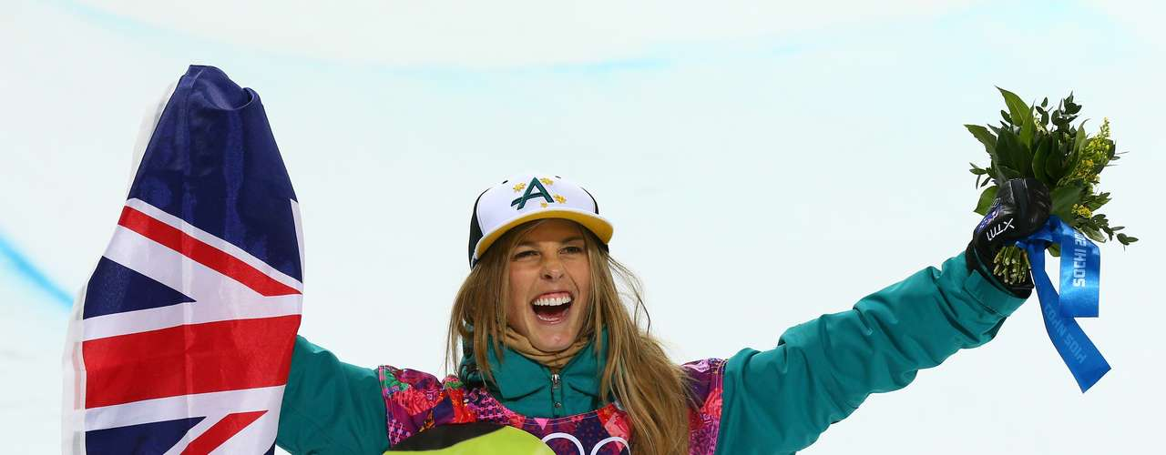 Silver medalist Torah Bright of Australia celebrates during the flower ceremony for the Snowboard Women's Halfpipe Finals.