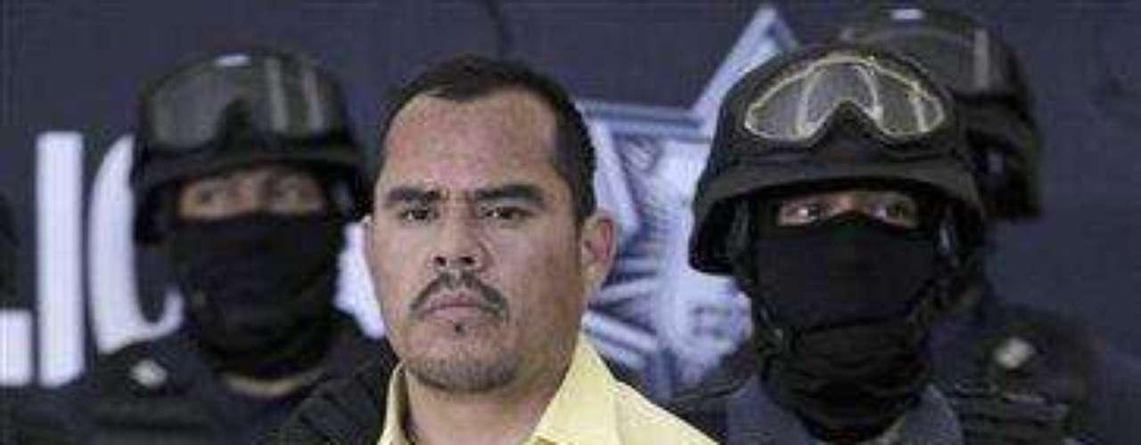 La policía dijo que Guzmán estaba involucrado en el carro-bomba que explotó una estación de policía federal de la Ciudad de Juárez en julio del 2010. Fuente: AP