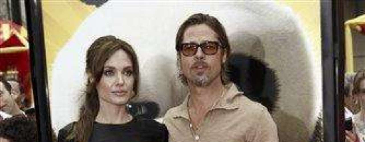 """Cast member Angelina Jolie, left, and Brad Pitt arrive at the premiere of """"Kung Fu Panda 2"""" in Los Angeles, Sunday, May 22, 2011.  The film opens May 26, 2011. (AP Photo/Matt Sayles)"""