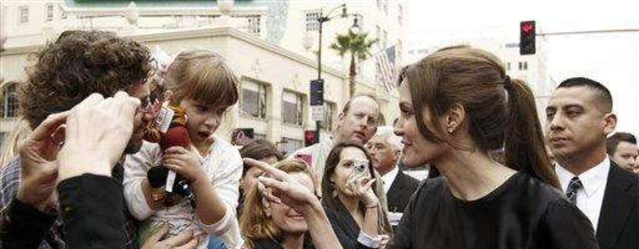 """Cast member Angelina Jolie, right, speaks to a young fan at the premiere of """"Kung Fu Panda 2"""" in Los Angeles, Sunday, May 22, 2011.  The film opens May 26, 2011. (AP Photo/Matt Sayles)"""