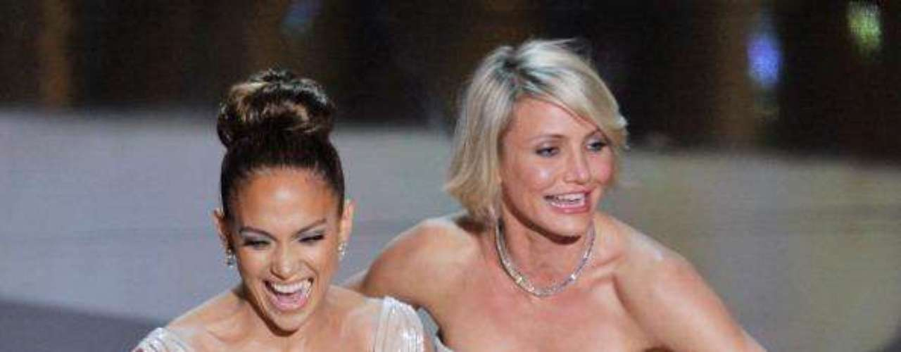 Jennifer Lopez made nipple pasties legendary with her famous Versace dress, but those pasties didn't quite stick at the Oscars this year.  Although many may claim that it never happened, while others shout from the roof tops that it did, we are merely indulging those who just want to know.The truth is... we saw it.  It peeked out, more of a peek-a-boo! Not a full out nip slip.  We are guessing that Cameron discovered this little problem, or maybe one of the powers that be at the Oscars, which is why the girls turned around before they presented the winners.  They showcased their bountiful backsides and tried to sync their voices for the big reveal.  Quick thinking, followed by a giggle fest, which gave it away.  This was not planned, and neither was the nip slip.  See if you can spot the nip slip that never was!Best & Worst Dressed on the Oscars 2012 Red Carpet I  JLo Heats Up The Oscars In Cool California