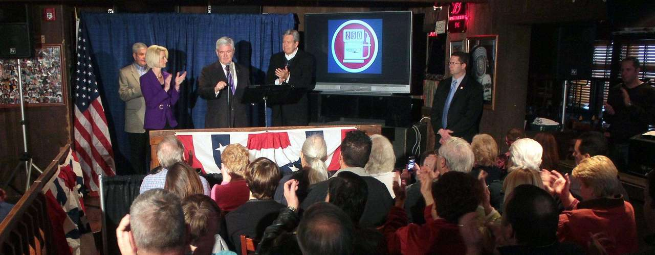 Republican presidential candidate, former House Speaker Newt Gingrich, with his wife Callista Gingrich, speaks at a rally at the Back Porch Saloon, Saturday, March 3, 2012, in Hamilton Ohio. (AP Photo/Tony Tribble)