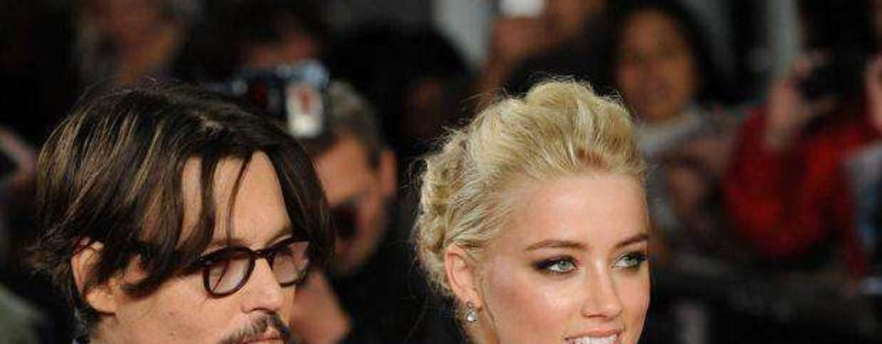 """Hace cuestión de días, el agente de Johnny Depp hizo pública la separación del actor y la modelo Vanessa Paradis. Tras la confirmación de la ruptura, se han venido dando diversos rumores que señalan a Amber Heard, quien fue este año compañera de rodaje de Depp en """"The Rum Diary"""", como la reciente amante del protagonista de """"Piratas del Caribe"""". Los rumores –aunque han incrementado tras la separación de Depp y Paradis– se remontan a finales de 2011 cuando la también modelo de 26 años participó de la adaptación al cine del libro de Hunter S. Thompson junto a Johnny. Vanessa Paradis es cosa del pasado, ¿qué opinas de la mujer que podría significar el nuevo futuro del actor?"""
