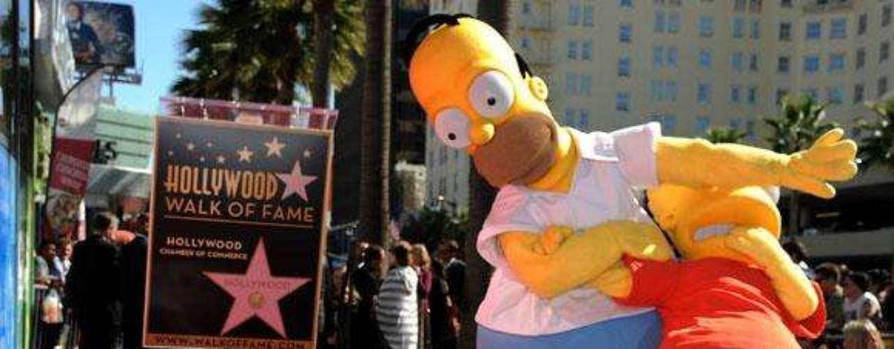 Estrellas animadas. Las series  y personajes animados también tienen un puesto en este exclusivo lugar;  los Simpson, Mickey Mouse, Bugs Bunny, Tinker Bell, el pato Donald, Blanca Nieves, Shrek, Rugrats, El Pájaro Loco y el oso  Winnie the Pooh son los dibujos animados que presumen de tener una estrella. Dos personajes de Plaza Sésamo, la Rana René  y Abelardo, son  los únicos títeres presentes en el Paseo de la Fama.