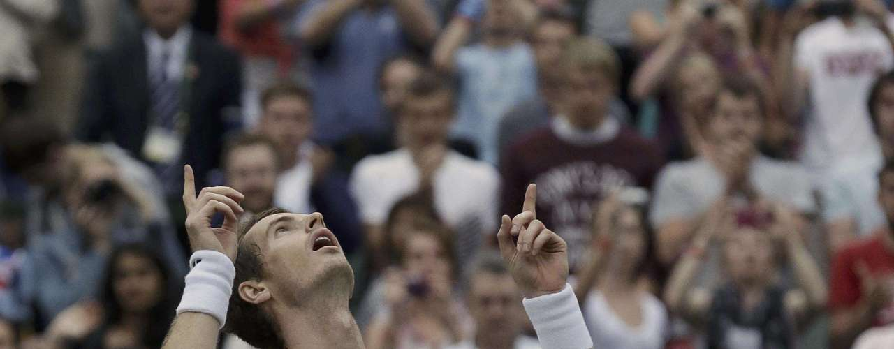 Andy Murray of Britain reacts after defeating Nikolay Davydenko of Russia during a match at the All England Lawn Tennis Championships at Wimbledon, England, Tuesday, June 26, 2012. (AP Photo/Anja Niedringhaus)