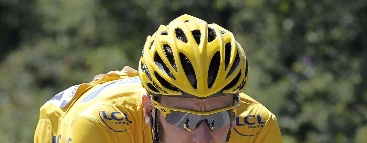 Sky Procycling rider and wearer of the leader's yellow jersey Bradley Wiggins of Britain cycles during the tenth stage of the 99th Tour de France cycling race between Macon and Bellegarde-sur-Valserine, July 11, 2012.
