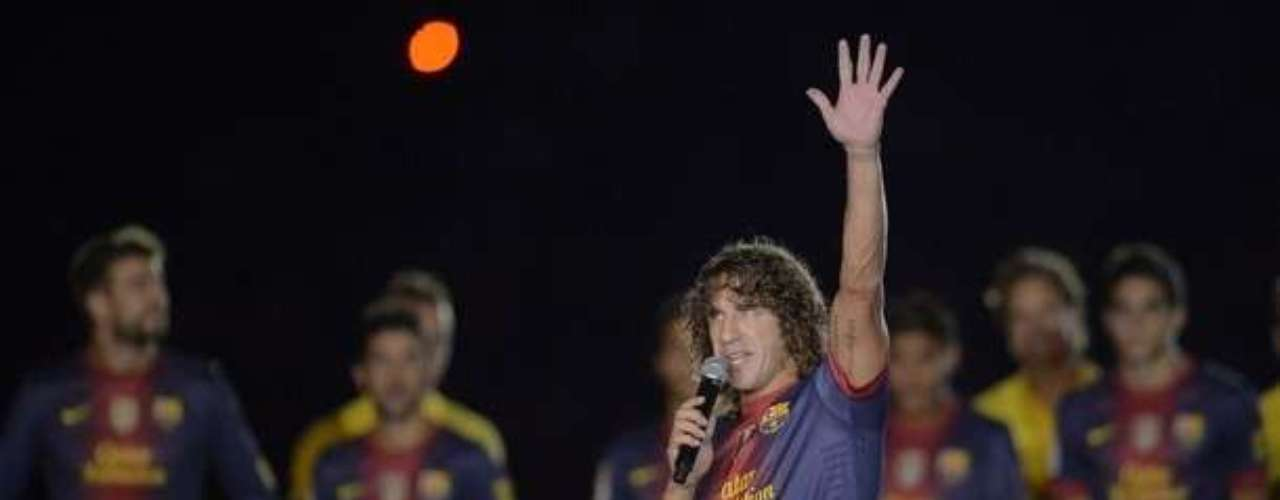 Captain Carles Puyol gives a short speech. He just extended his contract with Barcelona and said he would like to end his career at the club.