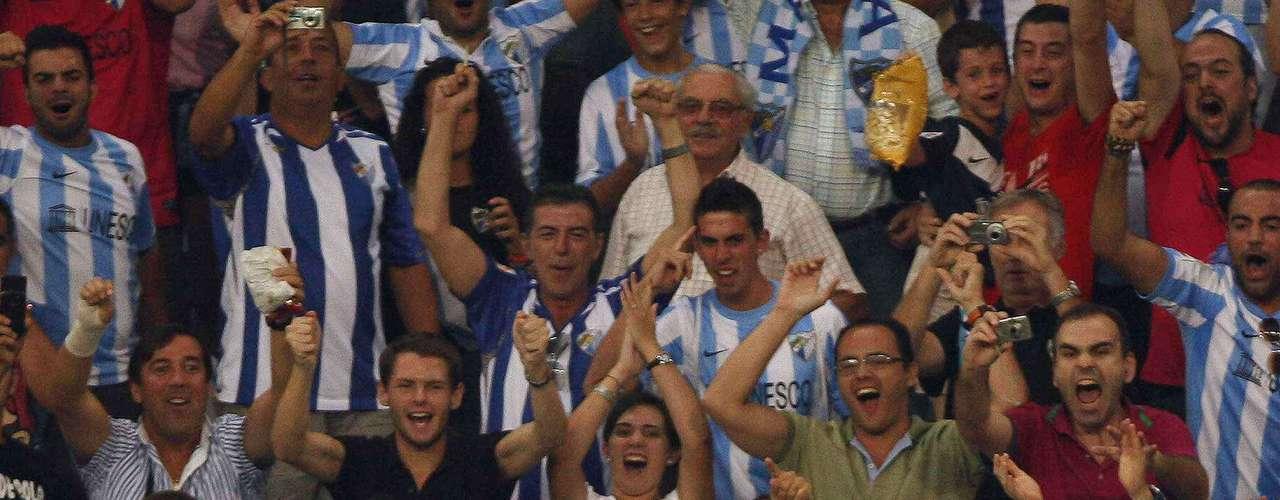 Malaga's Martin Demichelis shares his  joy with the Malaga faithful. REUTERS/Jon Nazca