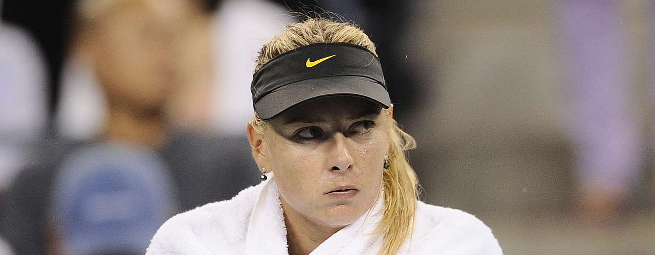 And why the angry face? Sharapova didn't like the rain during her match with Petrova, so she wasn't very happy when she had to cover herself with a towel when the match was interrupted.