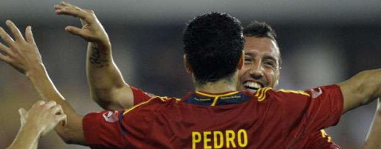 Pedro and Cazorla celebrate after the second Spanish goal.