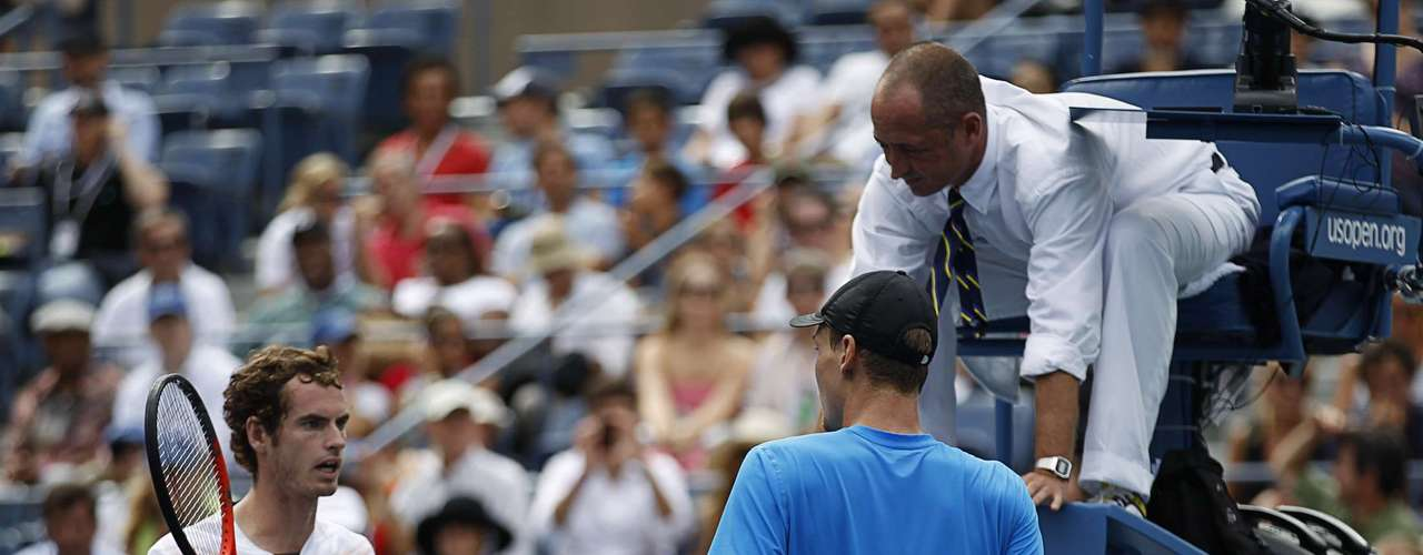 Andy Murray (L) of Britain questions a call by the referee.