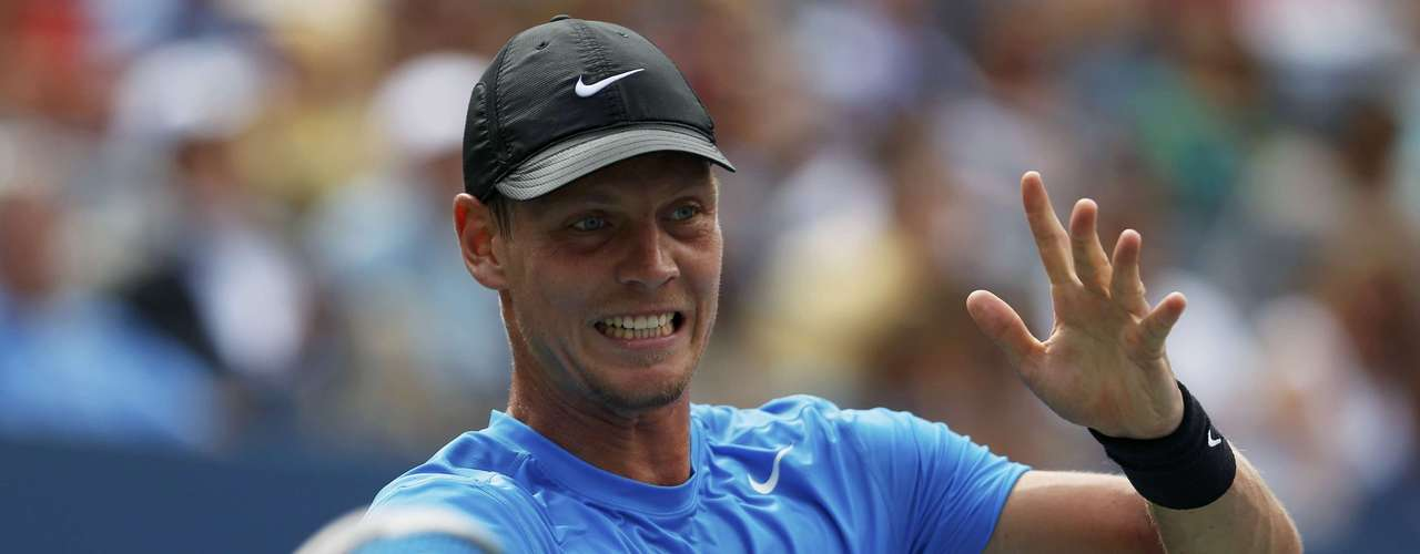 Tomas Berdych of the Czech Republic hits a return to Andy Murray.