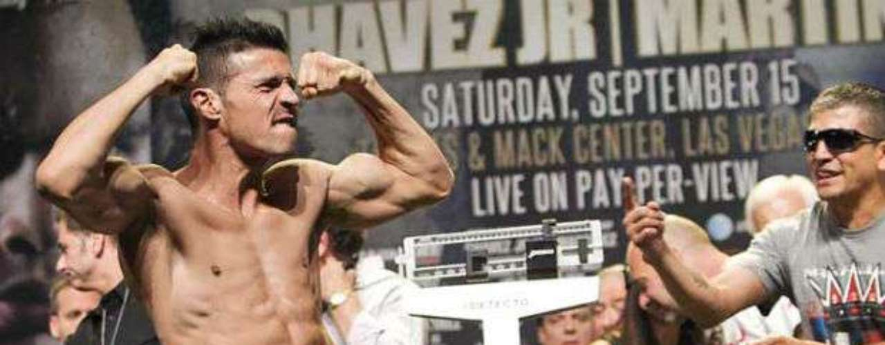 Martinez flexes his ripped physique for the fans.