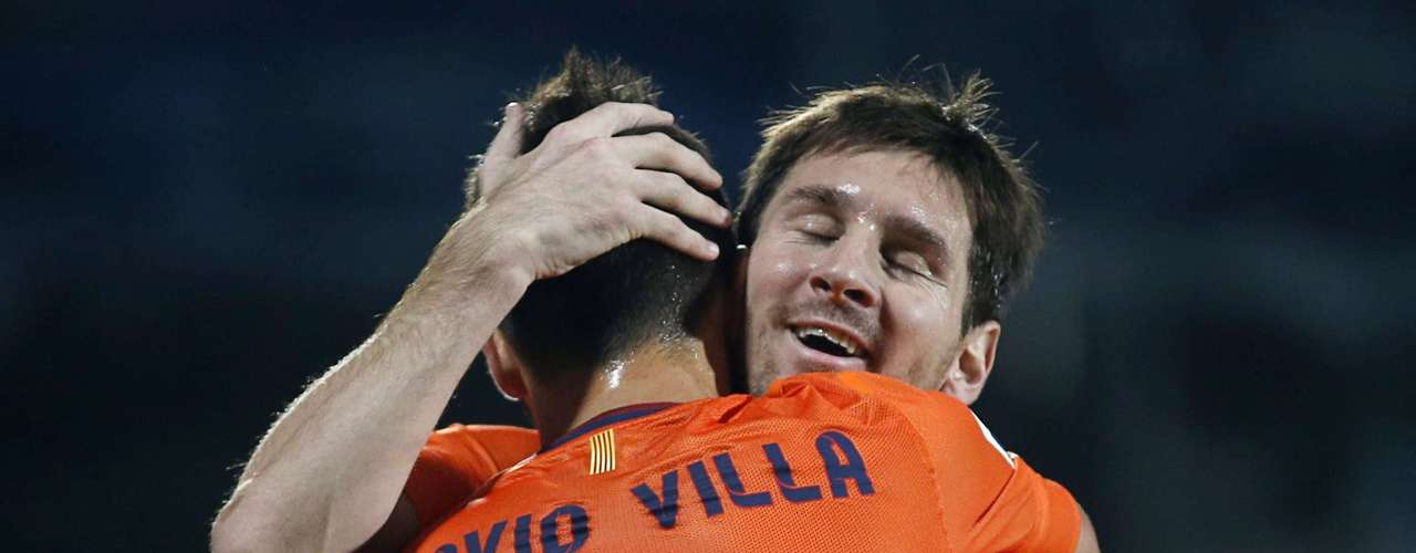 Barcelona's David Villa, seen here embracing Messi, also came off the bench to score in Barcelona's win. REUTERS/Sergio Perez