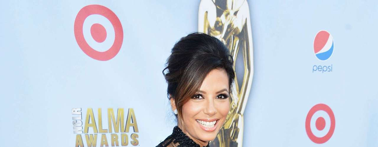 Eva Longoria has been the star and producer of the Alma Awards for the last couple of years. The 'Desperate Housewife' star was so 'fetch' in her black dress. We would've liked her to wear some color, but Eva looks dashing no matter what she wears. Fashion HIT!