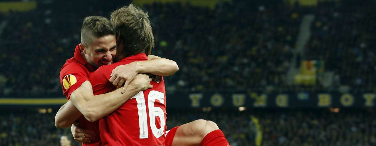 Liverpool's Sebastian Coates and Fabio Borini (L) celebrate after scoring their third goal. REUTERS/Pascal Lauener