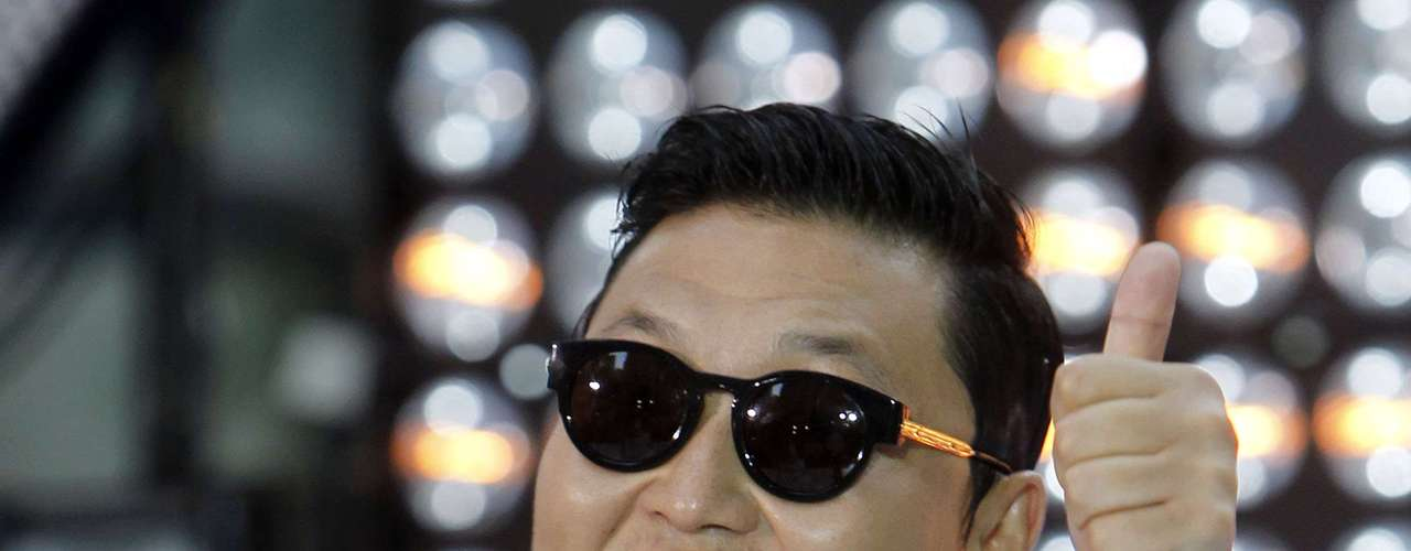 OMG this 'Gangnam Style' song and dance has gotten out of control. We are so over it but Psy has been touring NY performing his K-Pop hit song. What really caught our attention was his unique sense of style. He looks straight out of the 'Grease' movie and is definitely not 'haute.' What do you think of Psy's style, haute or not?