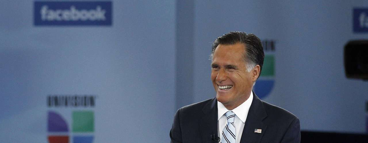 U.S. Republican presidential nominee and former Massachusetts Governor Mitt Romney smiles at Univision and Facebook's \