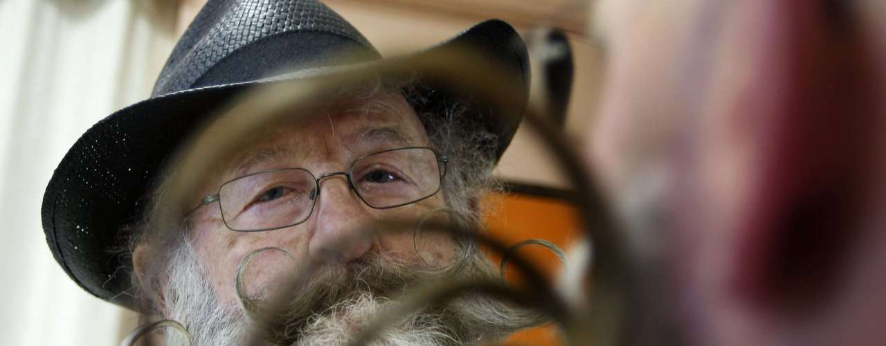 A participant is seen through the moustache of a fellow competitor as he helps him to get ready for the 2012 European Beard and Moustache Championships in Wittersdorf near Mulhouse, Eastern France, September 22, 2012. More than a hundred participants competed in the first European Beard and Moustache Championships organized in France. REUTERS/Vincent Kessler (FRANCE - Tags: SOCIETY)