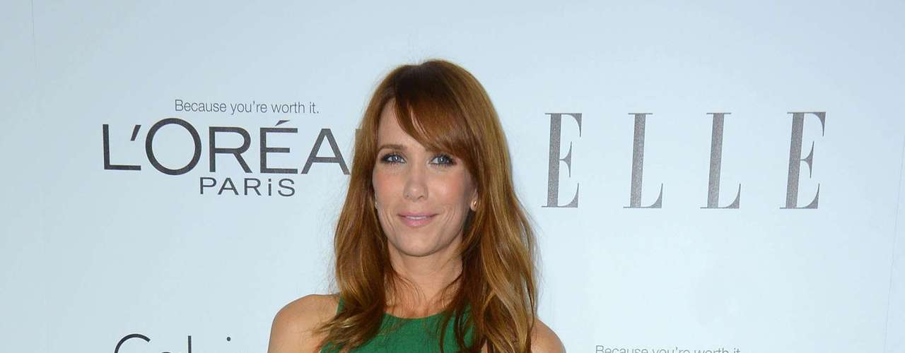 Kristen Wiig glows in a green Francisco Costa design for Calvin Klein.