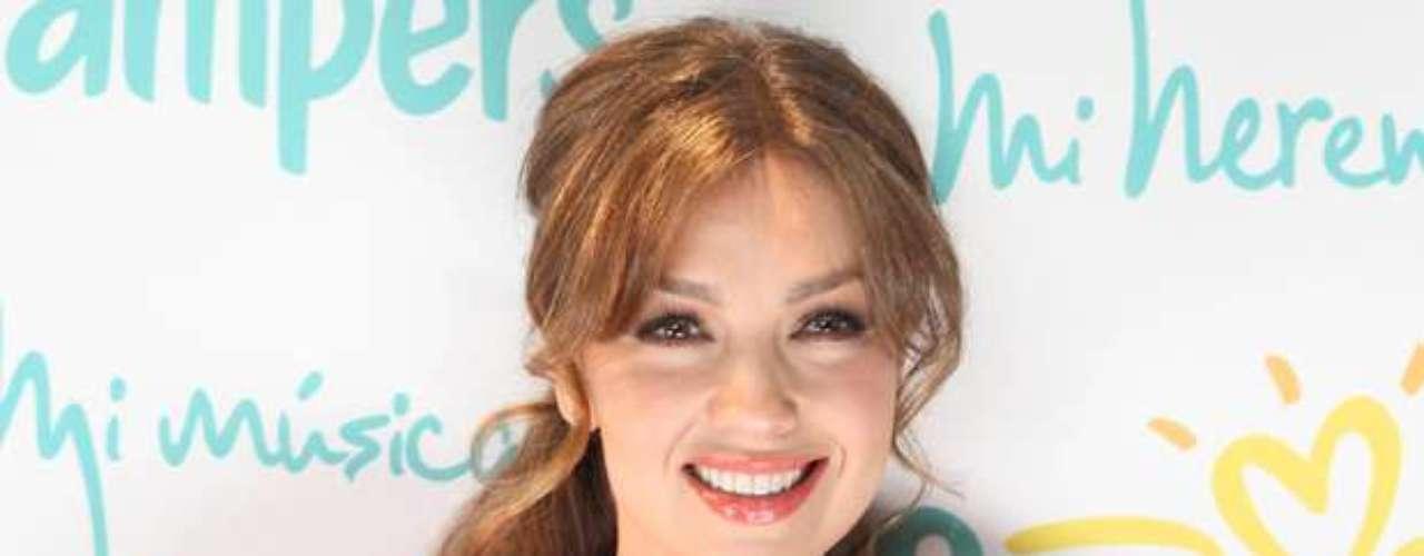 La esposa de Tommy Mottola, hizo gala de su mejor sonrisa durante el estreno del proyecto, patrocinado por una reconocida marca de pañales.