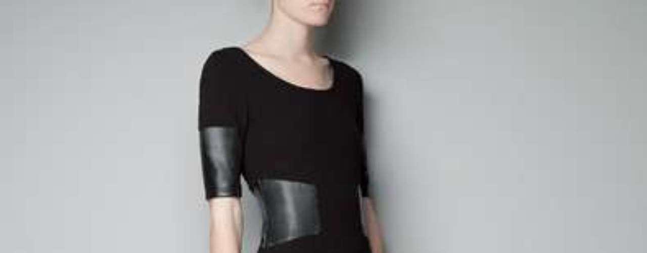 Un vestido negro entallado con apliques de cuero, el protagonista de la temporada. 69 dólares en Zara.com.