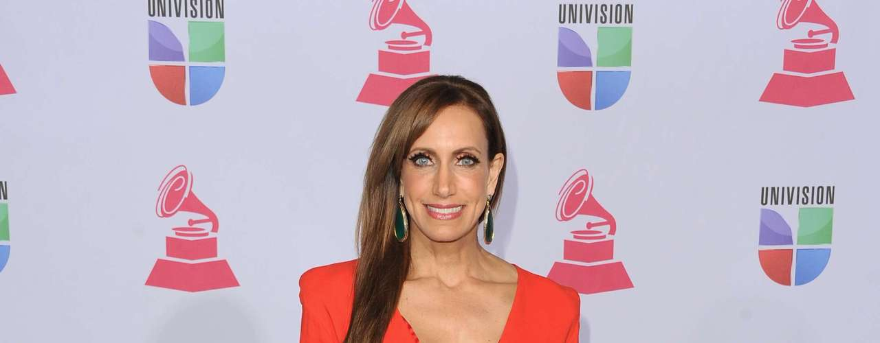 MISS: Lili Estefan looks like she is getting ready to get deployed. What is up with the shoulder pads?