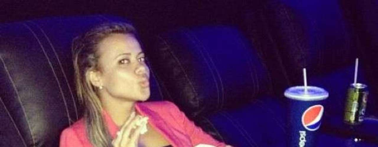 In this photo posted in Twitter, Ribeiro is at the movies by herself. She is looking for candidates to go with her.