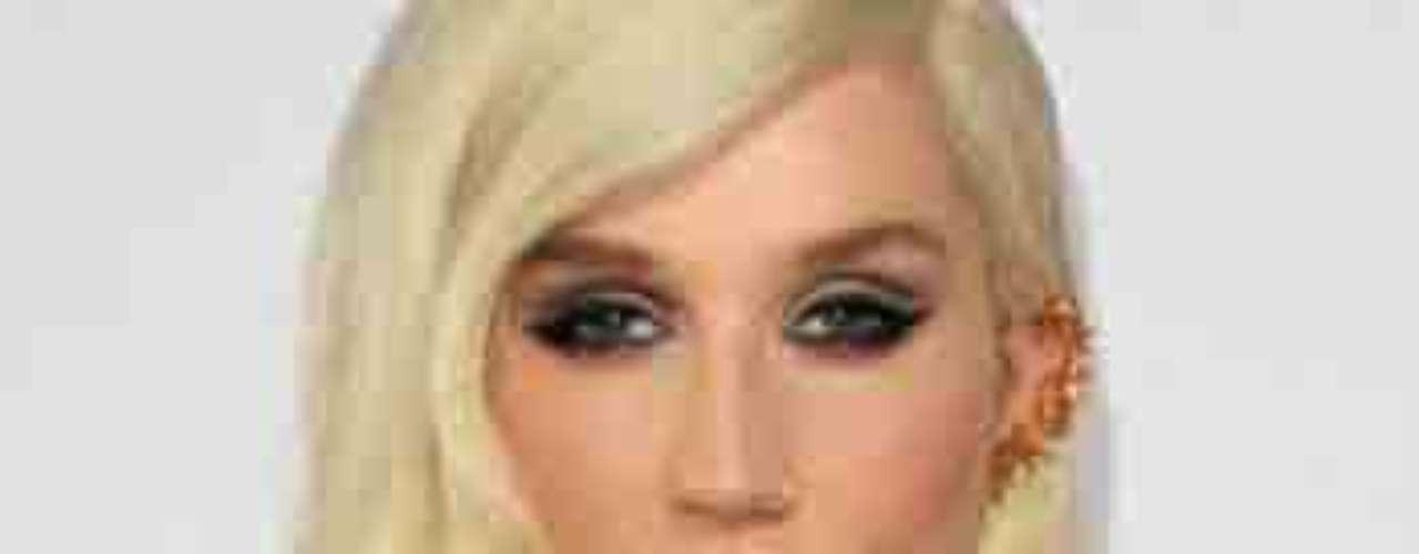 Kesha mostró su pequeña pero cumplidora pechonalidad, por la abertura de su vestido en los American Music Awards, realizados en el Nokia Theatre de Los Ángeles, el 18 de novimbre.