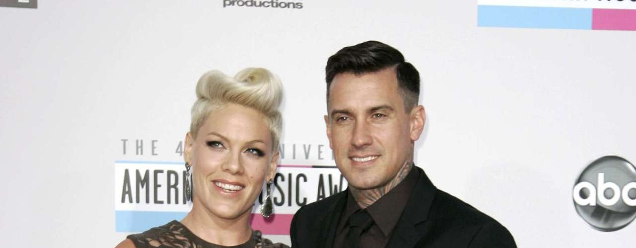 Singer Pink and her husband Carey Hart arrive at the 40th American Music Awards in Los Angeles, California, November 18, 2012.