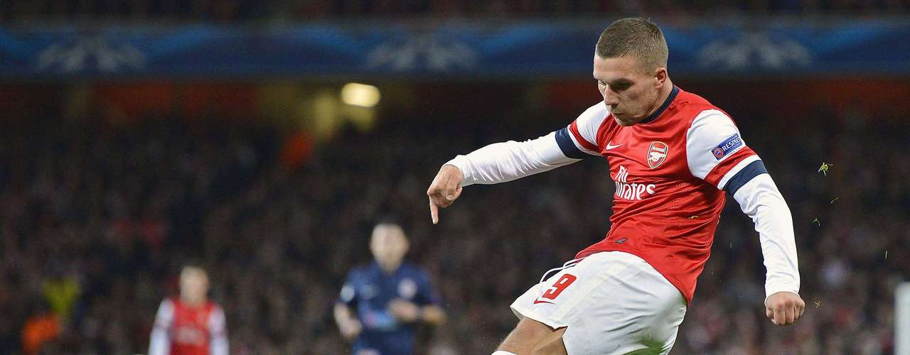 Arsenal's Lukas Podolski shoots on goal against Montpellier during their Champions League Group B soccer match at the Emirates Stadium in London November 21, 2012.