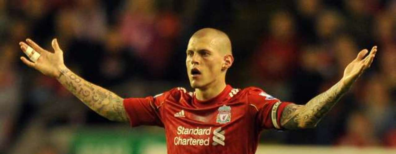 Martin Skrtel is another player at times known more for his tattoos than his play. He is also has a large tattoo covering his back.