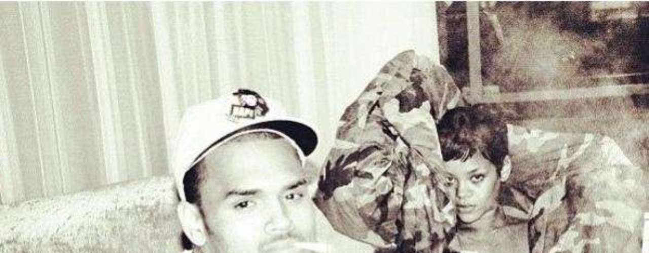 DECEMBER 3 - Chris Brown returns to Twitter after getting into fierce fight with a comedy writer and posts a picture of a scantily clad Rihanna and himself to celebrate.