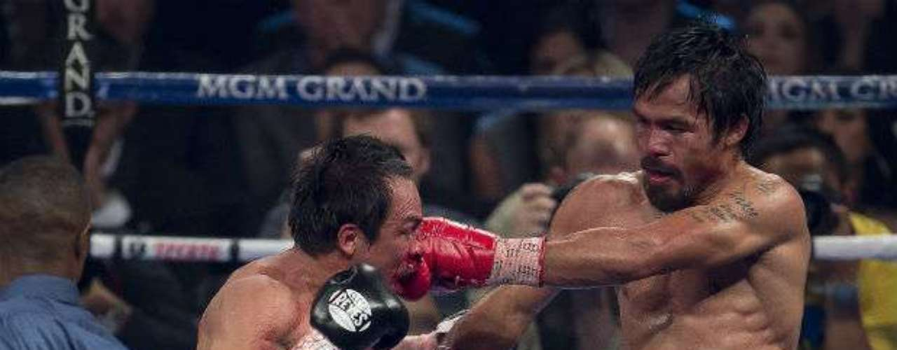 Pacquiao countered with a knockdown of his own that broke Marquez' nose.