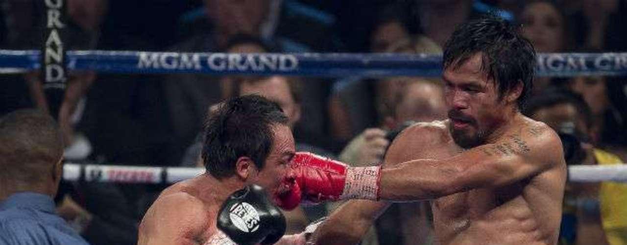 Márquez (55-6-1 y 40 KOs) cruzó con un derechazo a Pacquiao (54-5-2 y 38 KOs) al mentón saliendo de un intercambio y el asiático cayó completamente apagado a la lona.