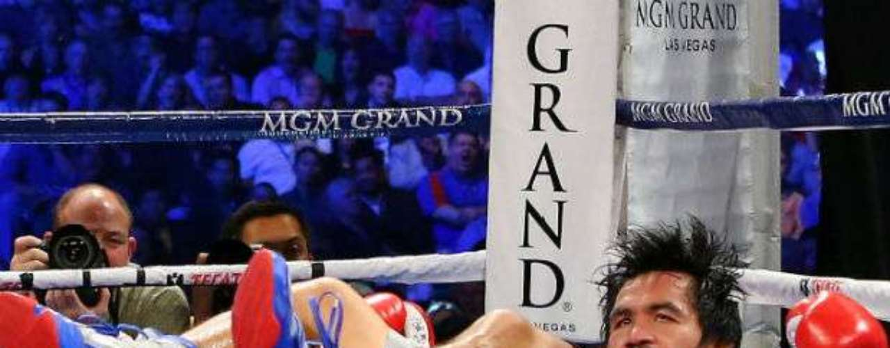 As Marquez celebrated, medics rushed over to Pacquiao, who remained unconscious on the ground.
