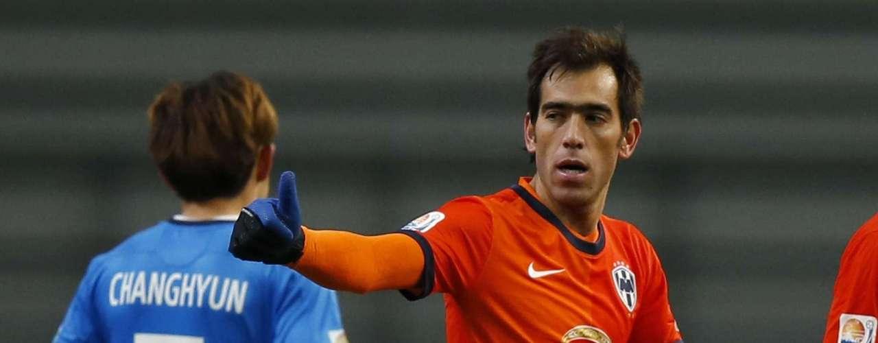 Cesar Delgado (R) of Monterrey celebrates after scoring his team's second goal.