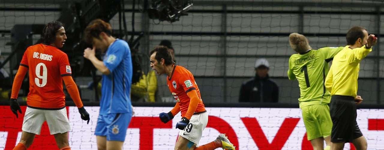 Cesar Delgado (C) of Monterrey celebrates after scoring his team's third goal.