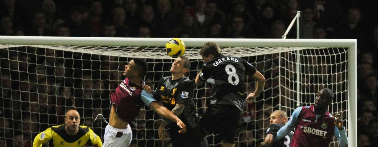 Liverpool's Steven Gerrard (C) scores an own goal during their English Premier League soccer match against West Ham at Upton Park in London December 9, 2012.