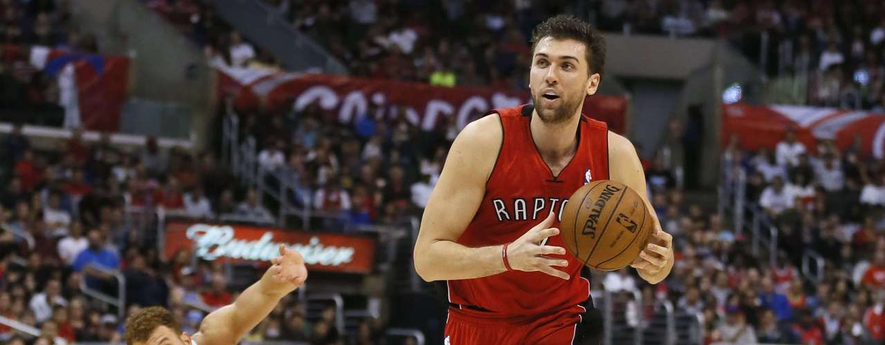 Toronto Raptors' Andrea Bargnani of Italy (R) drives to the basket past Los Angeles Clippers Blake Griffin during their NBA basketball game in Los Angeles, California, December 9, 2012.