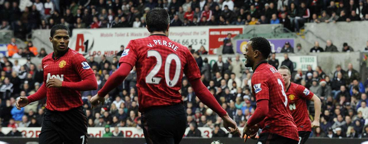 Manchester United's Patrice Evra (R) celebrates after scoring.