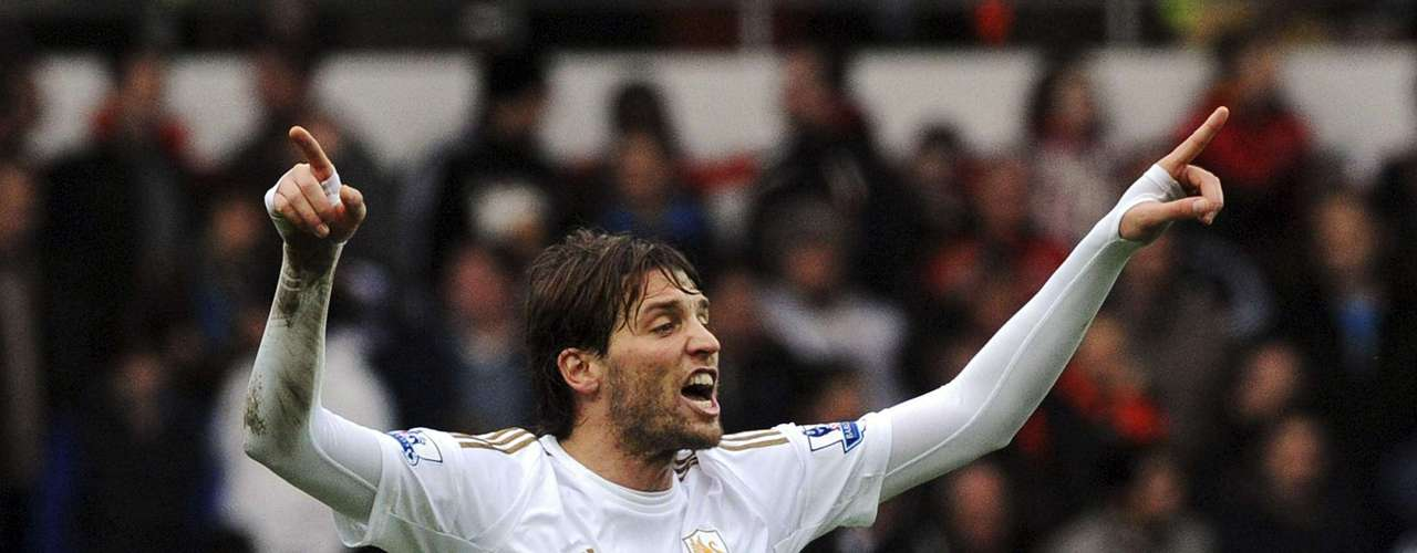 Michu celebrates afterr scoring the equalizer for Swansea City.